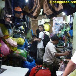 Philippinen - Schneider Barber und andere Geschäfte auf dem Markt